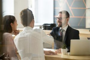 Financial Adviser Shaking Hands with Clients