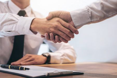 Loans - Two professionals handshaking on a loan deal