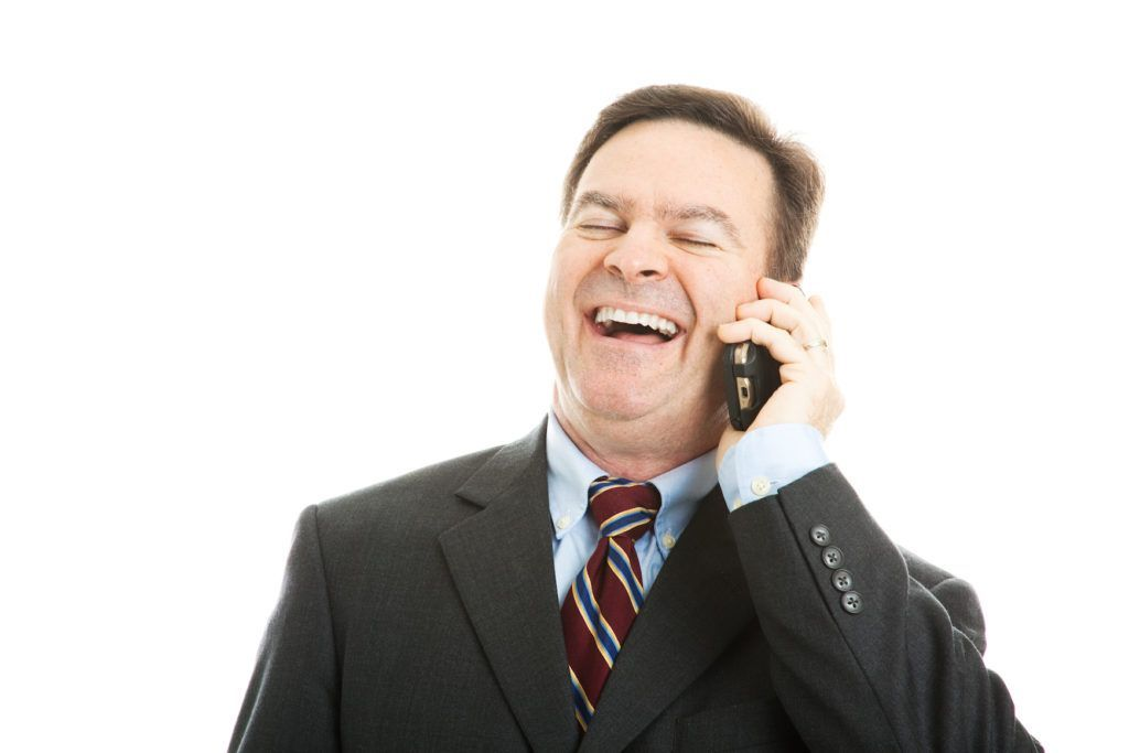 Businessman on the Phone Laughing at Voicemail