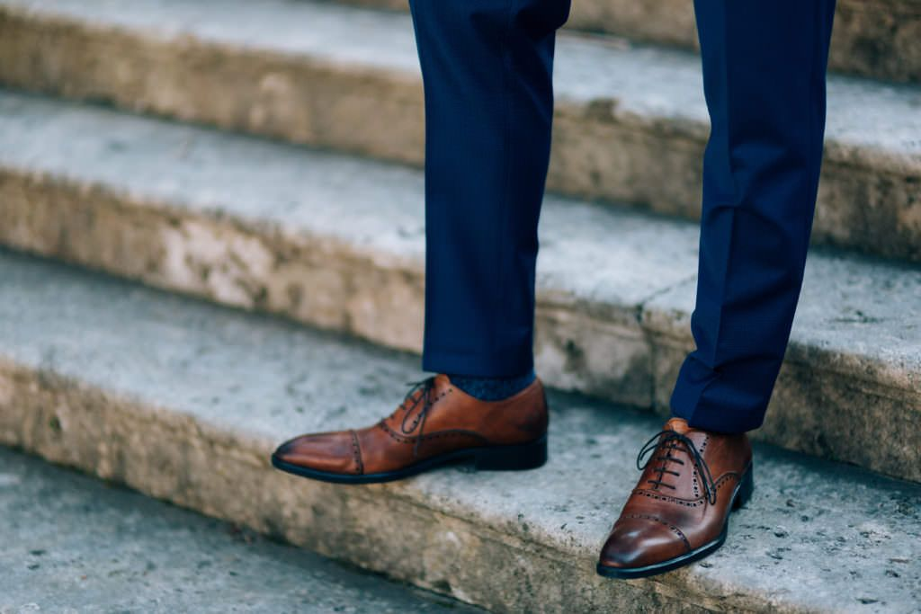 blue suit brown shoes