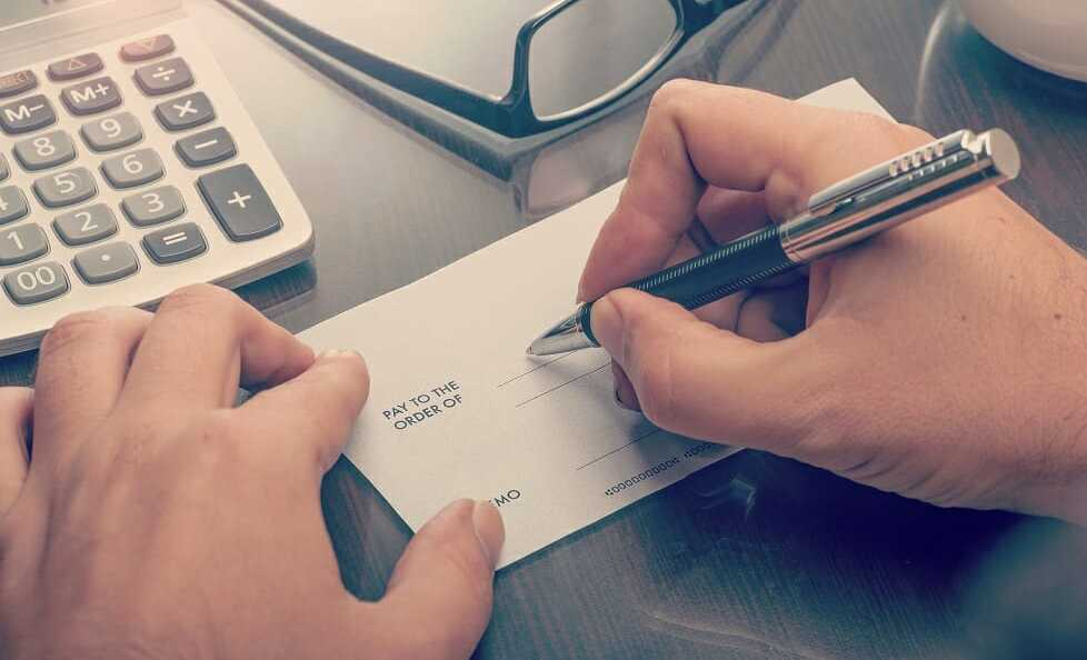 How to Write a Check - Hands on a Check