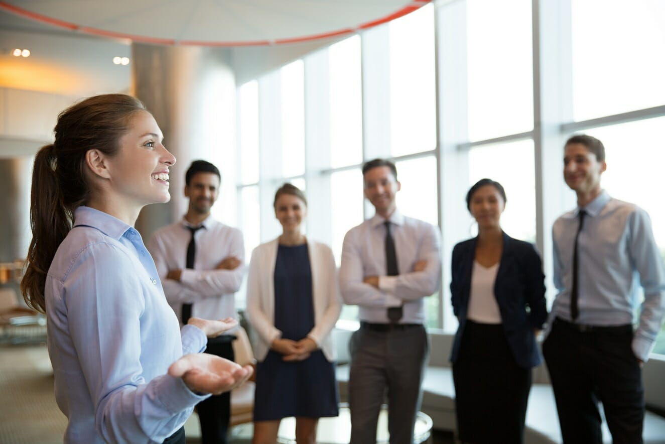 Management Skills - woman leading a group