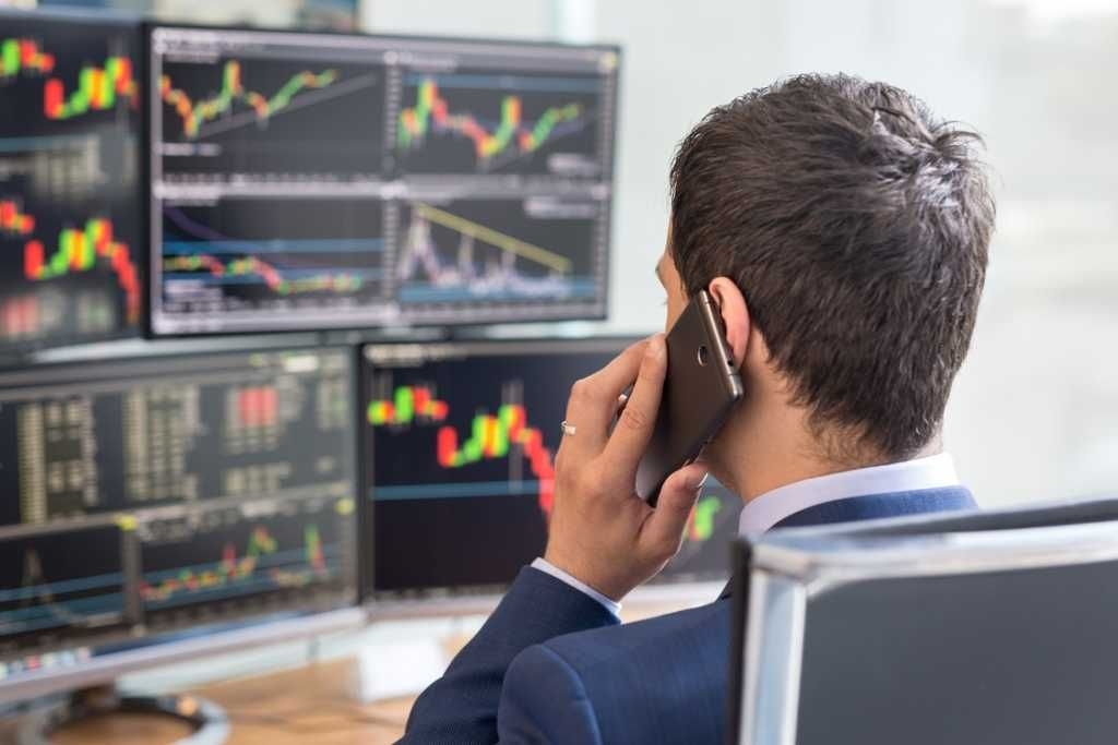 Sales and Trading Guide (trader at his desk)